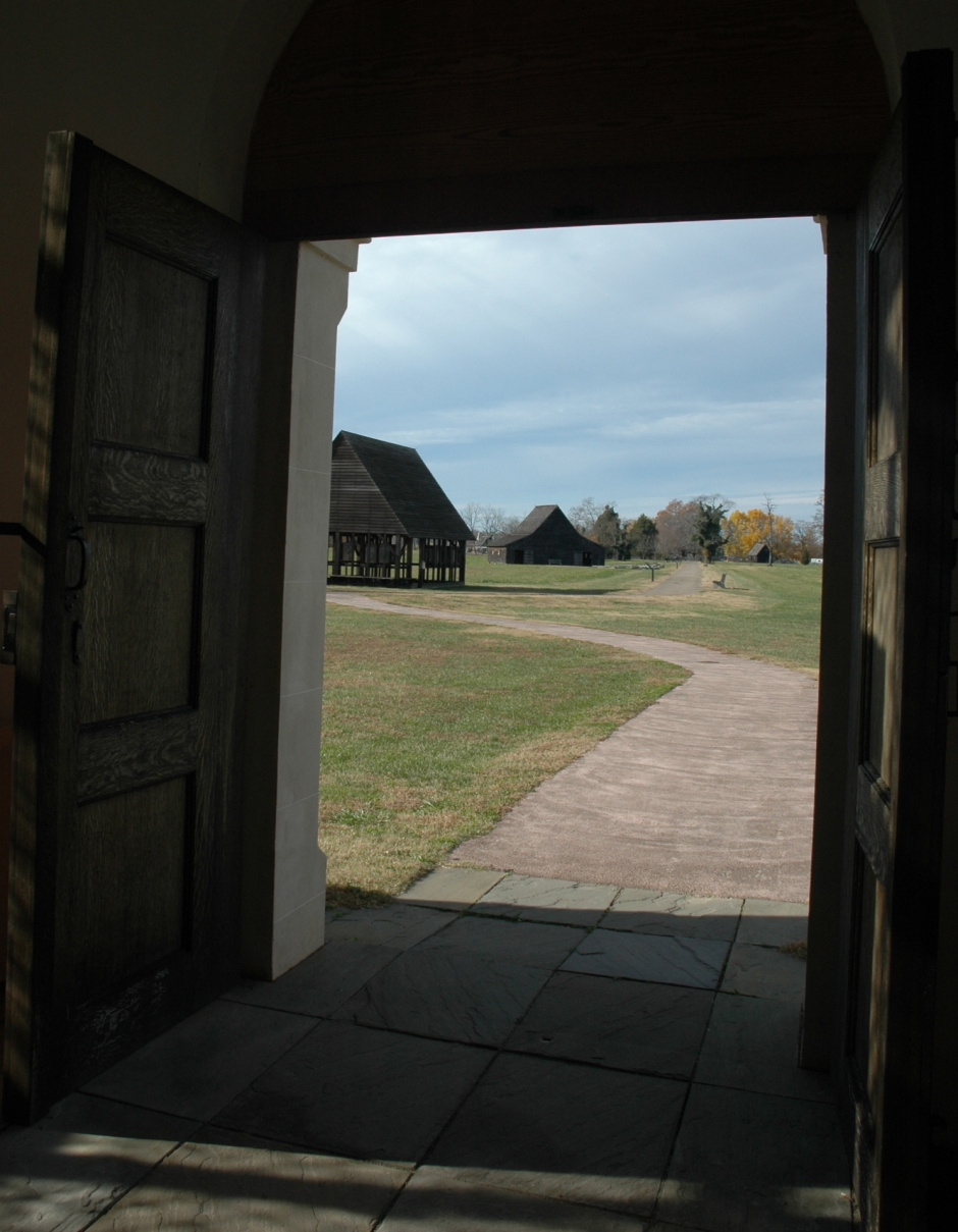 From the doorway of the reconstructed brick chapel. The structure in the background is the oldest wooden barn in Maryland. Photo: Margaret Yocom, 2013.