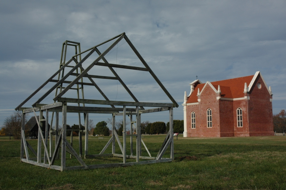 "Reconstruction of the 1667 brick chapel, with the ""ghost frame"" of an unknown building in the foreground. Photo: Margaret Yocom, 2013."