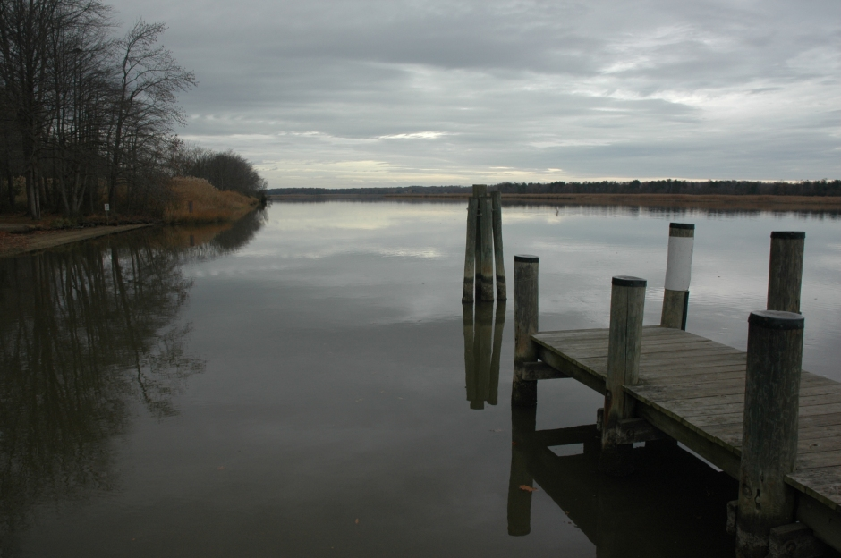 Looking upstream from the boat ramp, toward the site of the Magruder warehouse. Photo: Margaret Yocom, 2013.
