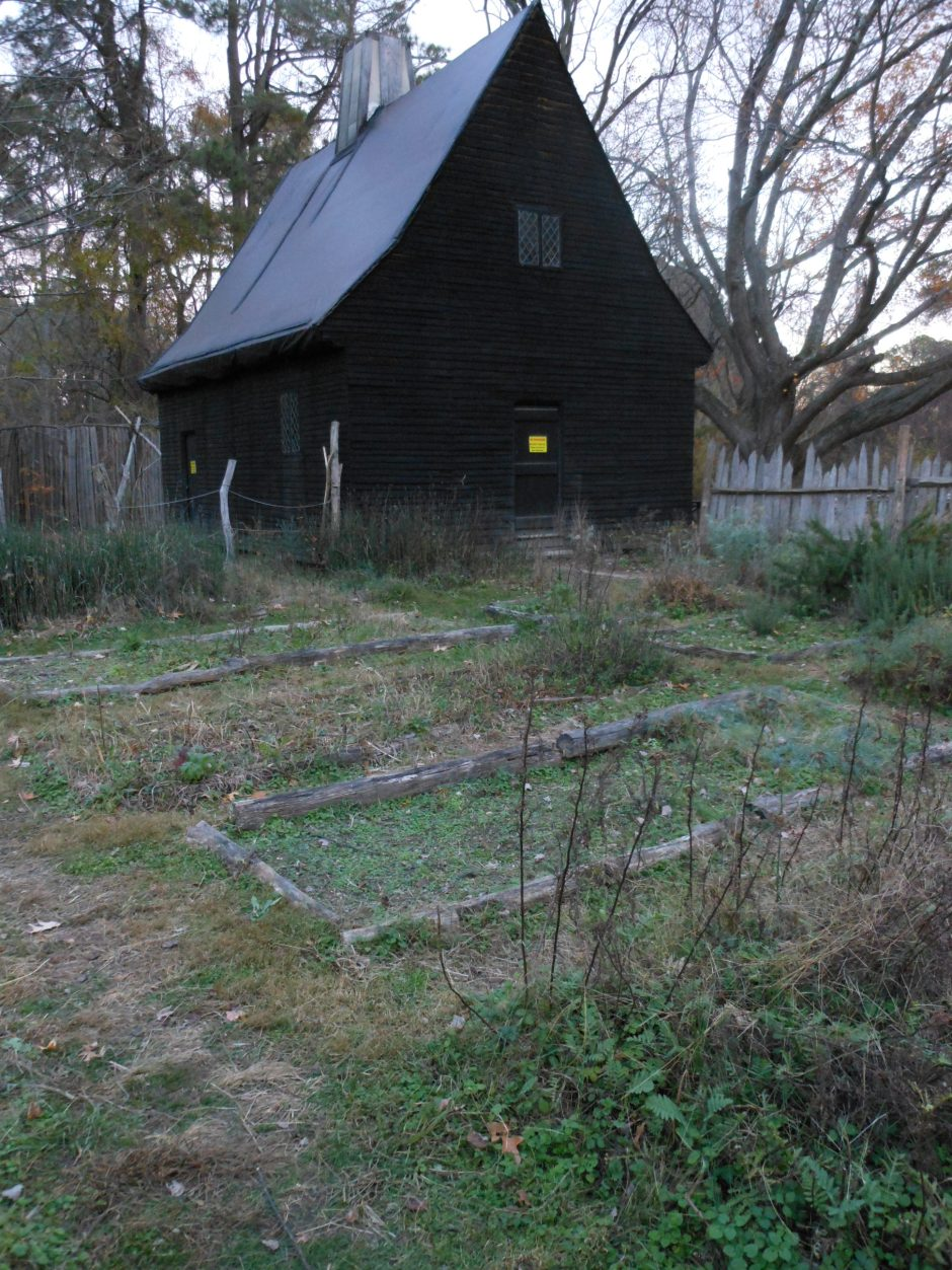 House and kitchen garden at Godiah Spray Plantation, Historic St. Mary's City, at twilight. Photo: Margaret Yocom, 2013